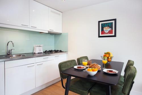 A kitchen or kitchenette at Stayci Serviced Apartments Central Station
