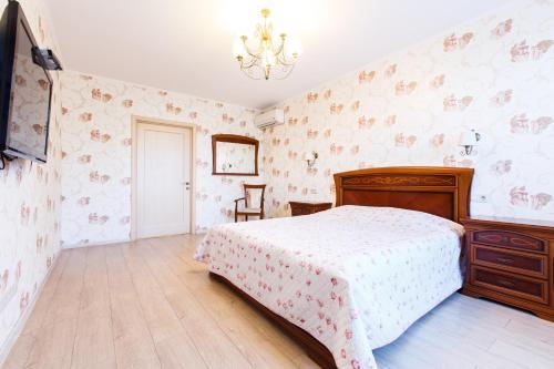 Кровать или кровати в номере Апартамент Люкс на Курортном