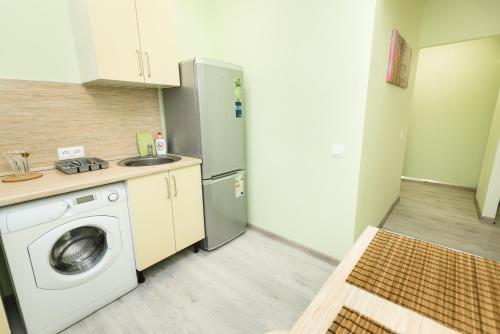 "A kitchen or kitchenette at ""SelimVseh"" at Universitetskiy"