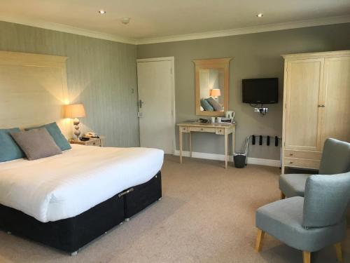 A bed or beds in a room at Netherwood Hotel & Spa