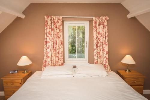 A bed or beds in a room at Friars Carse Country House Hotel
