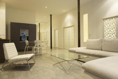 A seating area at Ausone Beautiful loft apartment in historical center + terrace and parking