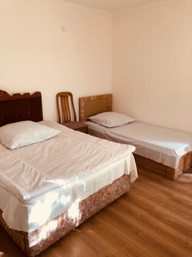 Кровать или кровати в номере Guest house Stalin