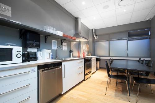 A kitchen or kitchenette at Galaxy Pod Hostel
