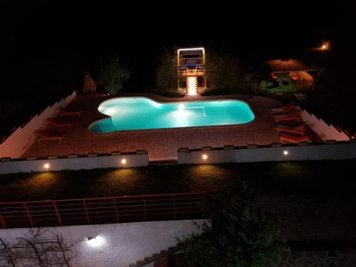 Vista sulla piscina di Il Sogno di Alghero o su una piscina nei dintorni