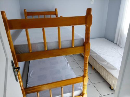 A bunk bed or bunk beds in a room at Sobrado Próx Centro Eventos