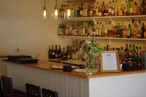 The lounge or bar area at Summer Isles Hotel