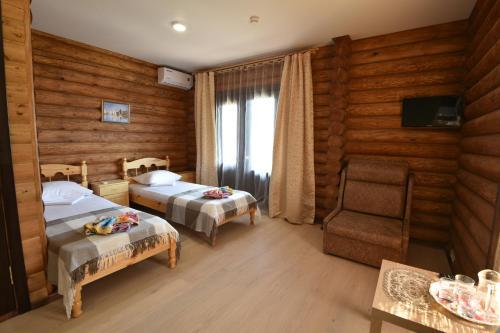 Кровать или кровати в номере Pension Mini Wonderful Valley