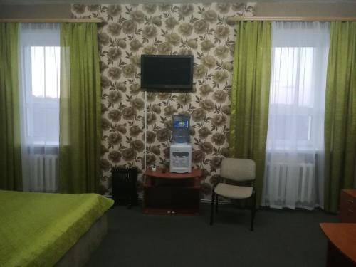 Телевизор и/или развлекательный центр в Гостиница Новый Континент