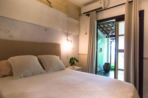 A bed or beds in a room at Casa di Ornella b&b