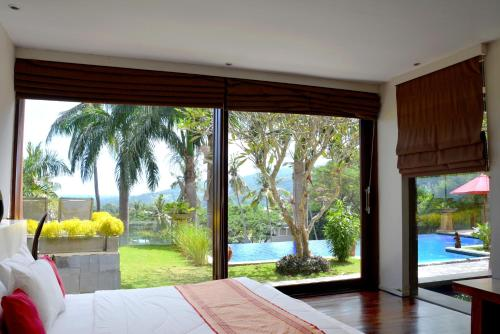 A view of the pool at Villa Tiara or nearby