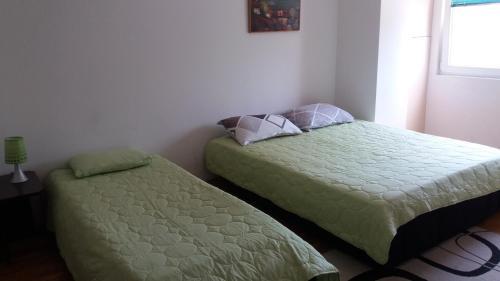 Postelja oz. postelje v sobi nastanitve Ms.Melody Apartment