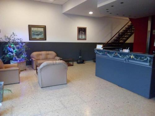 El lobby o recepción de Petit Hotel