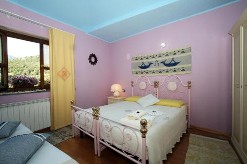 A bed or beds in a room at B&B Su Biancu