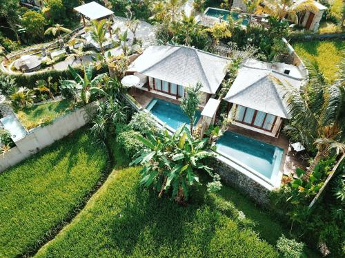 A view of the pool at Nau Villa Ubud or nearby