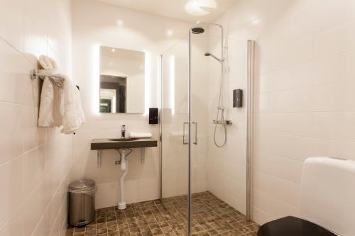 Ett badrum på Hotell Nordic