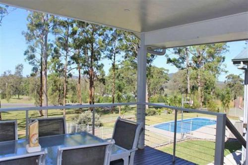 A view of the pool at Banyula, 103 Neville Morton Drive or nearby