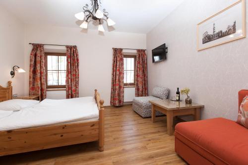 Postel nebo postele na pokoji v ubytování Penzion Onyx
