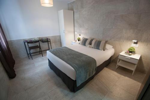 A bed or beds in a room at Hospedería Los Angeles