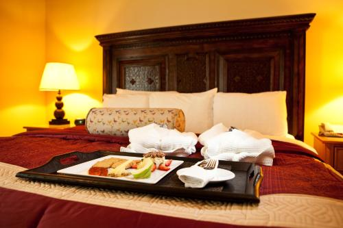 A bed or beds in a room at La Posada Hotel