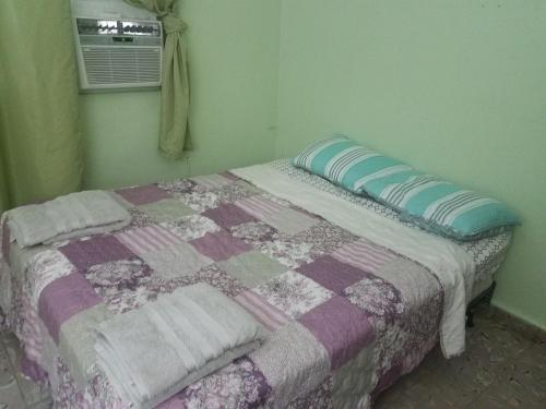 A bed or beds in a room at Alondra San Juan Apartments
