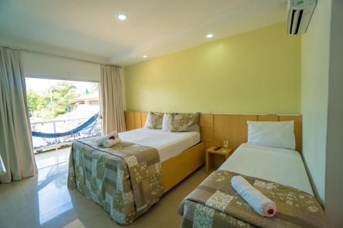 A bed or beds in a room at Resort Pau Brasil All Inclusive