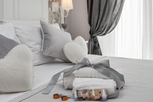 Letto o letti in una camera di Charme & Chic
