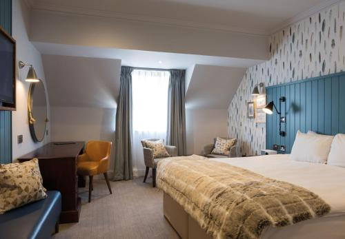 A bed or beds in a room at Solent Hotel and Spa