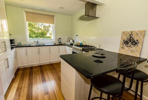 A kitchen or kitchenette at Paddys Creek Retreat