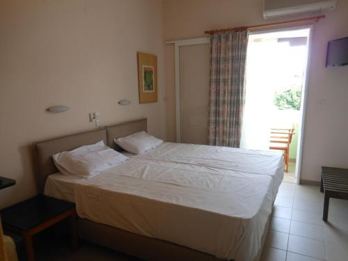 Un pat sau paturi într-o cameră la Pension Itzes