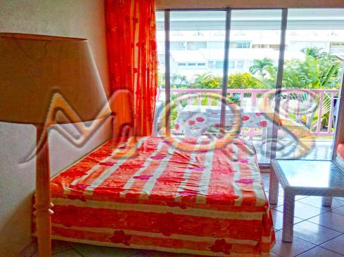 Giường trong phòng chung tại Marina Quality Stay Guadeloupe