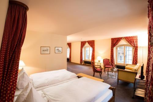 Ein Bett oder Betten in einem Zimmer der Unterkunft Hotel Stadthaus