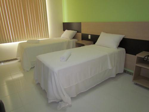 A bed or beds in a room at Pousada Menina Bonita