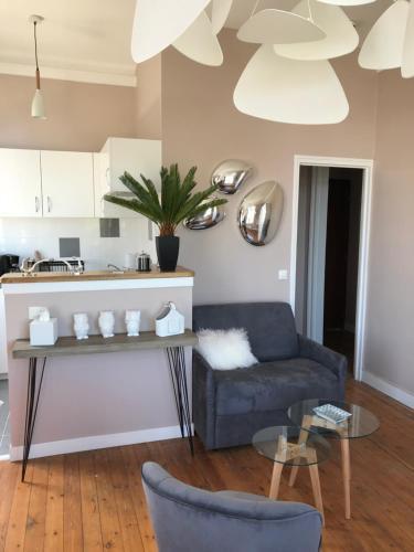 A kitchen or kitchenette at Studio en Bord de Mer