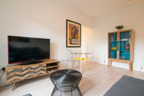 A television and/or entertainment center at Burton House Boutique Flat