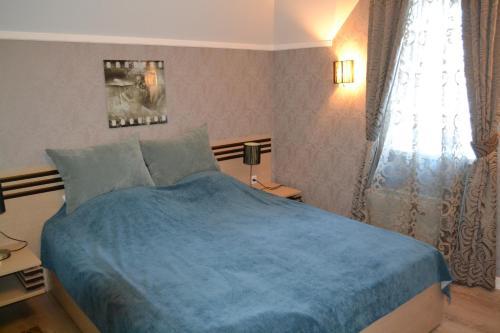 Кровать или кровати в номере Гостевой Дом Truvil