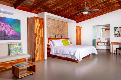 A bed or beds in a room at El Castillo - Adults only