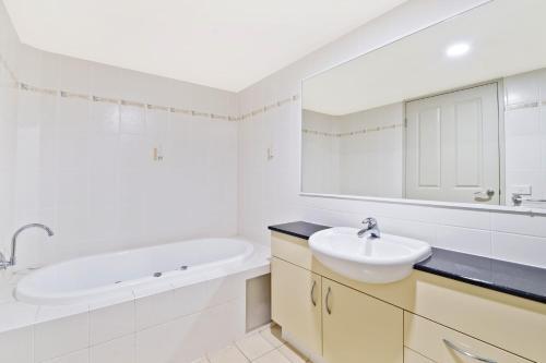 A bathroom at Flightdeck 301 5-7 Clarence Street