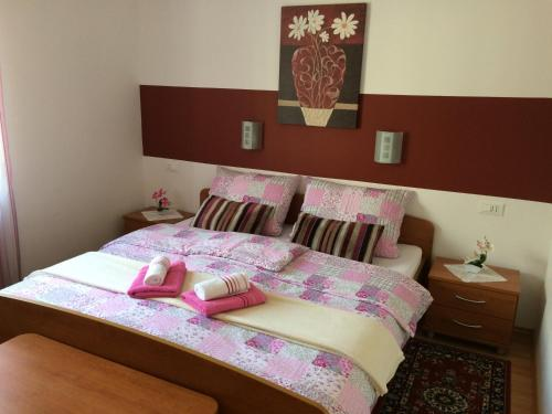 A bed or beds in a room at Apartments and Rooms Tavcar