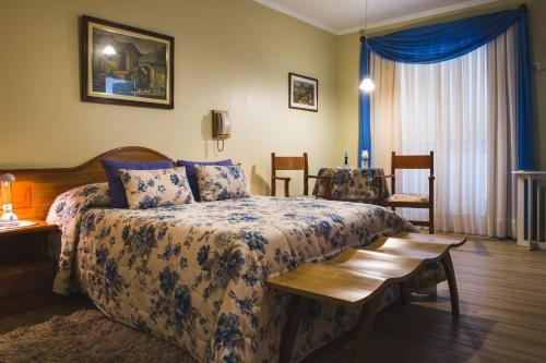Cama ou camas em um quarto em Hotel Pousada da Neve