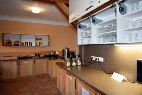 A kitchen or kitchenette at Travel Hostel