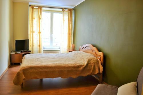 A bed or beds in a room at Central Flat on Halytska Str