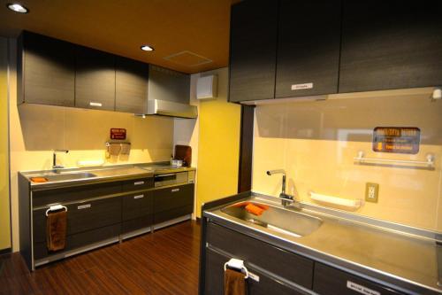 A kitchen or kitchenette at K's House Takayama [1st K's Hostel]