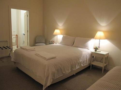 A bed or beds in a room at The Playhouse Hotel