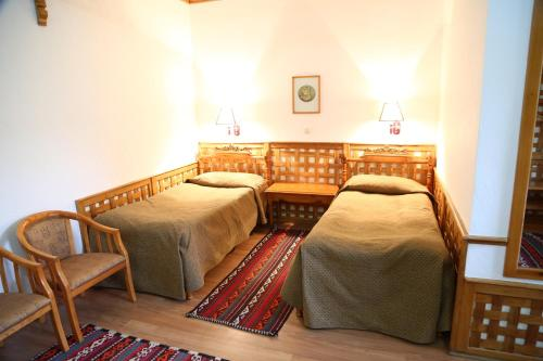 Кровать или кровати в номере Отель Малика Классик