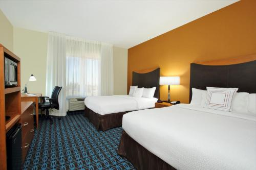 A bed or beds in a room at Fairfield Inn & Suites Fresno Clovis