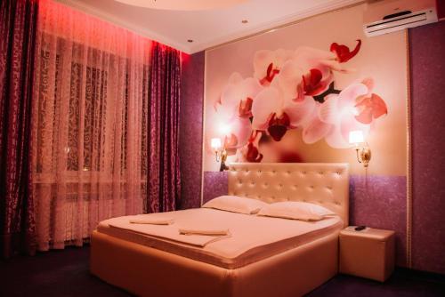 Кровать или кровати в номере Гостиница Империя
