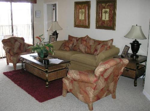 A seating area at Mediterranean 4 Bedroom 3 Bath Pool Home Near Disney