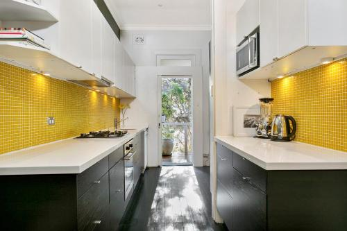A kitchen or kitchenette at Jacques Avenue - A Bondi Beach Holiday Home