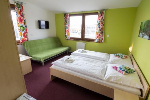 Postel nebo postele na pokoji v ubytování Penzion Maděřič